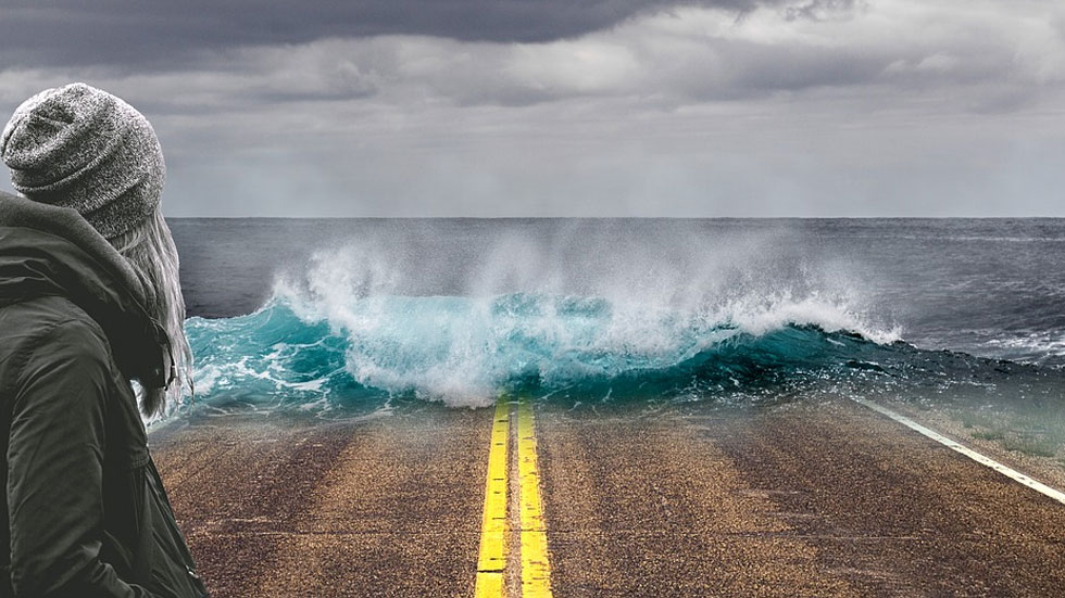 wave crashing over road